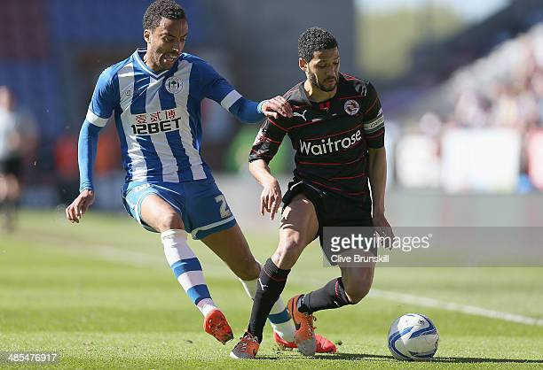 James Perch of Wigan Athletic in action with Jobi McAnuff of Reading during the Sky Bet Championship match between Wigan Athletic and Reading at DW...