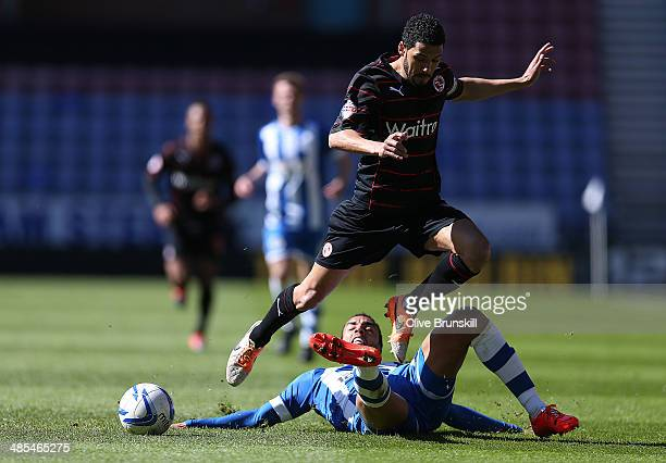 James Perch of Wigan Athletic slide tackles Jobi McAnuff of Reading during the Sky Bet Championship match between Wigan Athletic and Reading at DW...