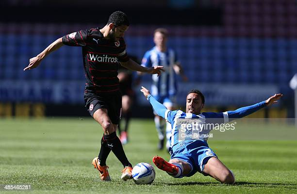 James Perch of Wigan Athletic tackles Jobi McAnuff of Reading during the Sky Bet Championship match between Wigan Athletic and Reading at DW Stadium...