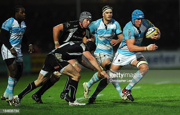 James Percival of Worcester gets away from James Hanks of Exeter during the AVIVA Premiership match between match between Exeter Chiefs and Worcester...