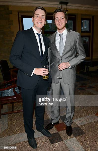 James Phelps and Oliver Phelps attend the celebrity golf classic drinks reception at the South Lodge Hotel on May 20 2013 in Horsham England