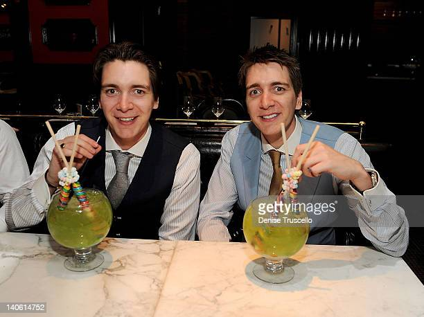 James Phelps and Oliver Phelps dine at Sugar Factory American Brasserie at Paris Las Vegas on March 2 2012 in Las Vegas Nevada