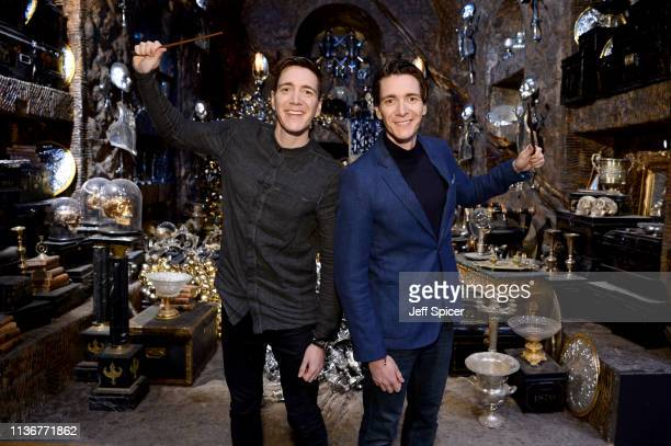 James Phelps and Oliver Phelps in the Lestrange Vault set at the original Gringotts Wizarding Bank at Warner Bros Studio Tour London on March 19 2019...