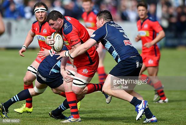 James Phillips of Bristol Rugby is tackled during the Greene King IPA Championship Play Off Semi Final first leg match between Bedford Blues and...