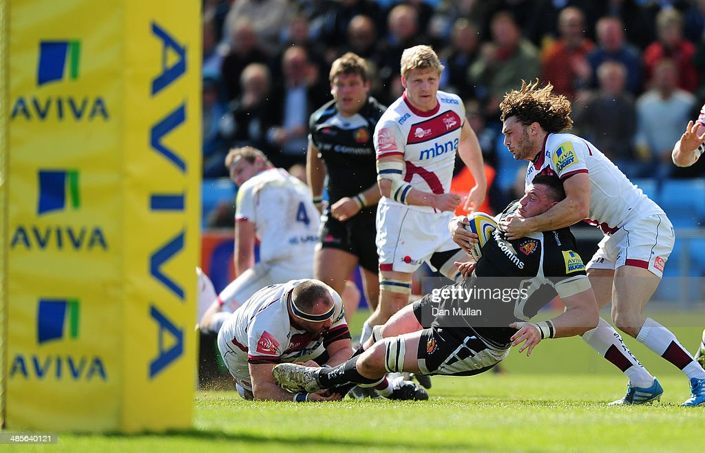 James Phillips of Exeter Chiefs is tackled by Tom Arscott of Sale Sharks during the Aviva Premiership match between Exeter Chiefs and Sale Sharks at Sandy Park on April 19, 2014 in Exeter, England.