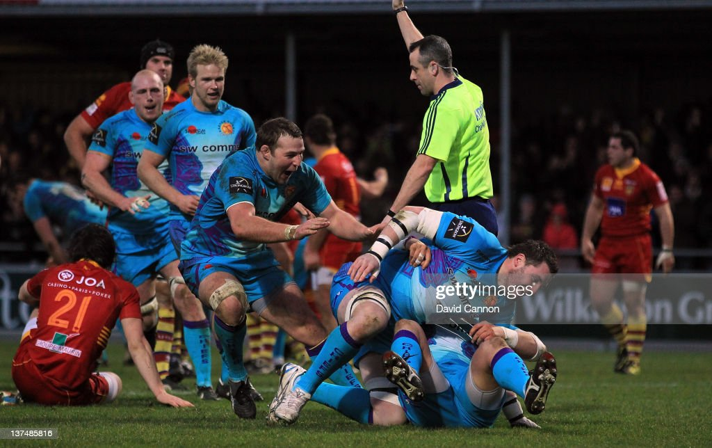 James Phillips of Exeter Chiefs scores Exeter's third try as Simon Alcott rolls him over (two right blue players as other Exeter players begin to celebrate during the Amlin Challenge Cup match between Exeter Chiefs and Perpignan at Sandy Park on January 21, 2012 in Exeter, England.