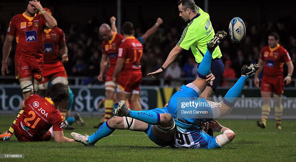James Phillips of Exeter Chiefs scores Exeter's third try as Simon Alcott rolls him over during the Amlin Challenge Cup match between Exeter Chiefs and Perpignan at Sandy Park on January 21, 2012 in Exeter, England.