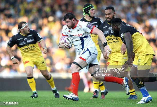 James Phillips of Sale Sharks is tackled by Danny Priso of Stade Rochelais during the Challenge Cup Semi Final match between La Rochelle and Sale...