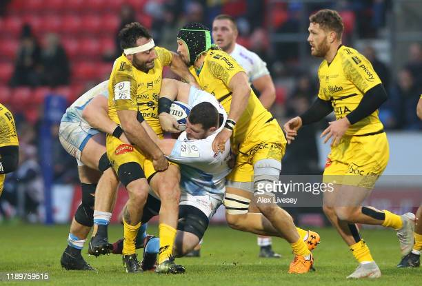 James Phillips of Sale Sharks is tackled by Jeremy Sinzelle of La Rochelle during the Heineken Champions Cup Round 2 match between Sale Sharks and La...