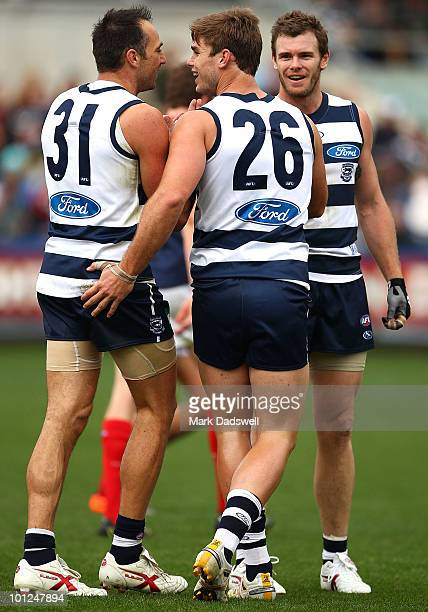James Podsiadly, Cameron Mooney and Tom Hawkins of the Cats celebrate a goal during the round 10 AFL match between the Geelong Cats and the Melbourne...