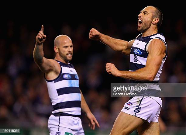 James Podsiadly of the Cats celebrates kicking a goal during the round 21 AFL match between the Geelong Cats and the St Kilda Saints at Etihad...