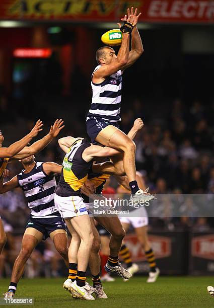 James Podsiadly of the Cats flies for a mark during the round 18 AFL match between the Geelong Cats and the Richmond Tigers at Etihad Stadium on July...