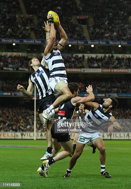 James Podsiadly of the Cats flies for a mark during the round eight AFL match between the Geelong Cats and the Collingwood Magpies at Melbourne...