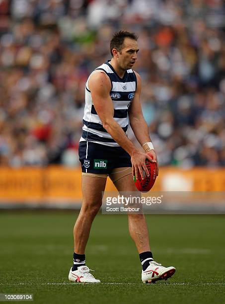 James Podsiadly of the Cats kicks the ball during the round 17 AFL match between the Geelong Cats and the Brisbane Lions at Skilled Stadium on July...