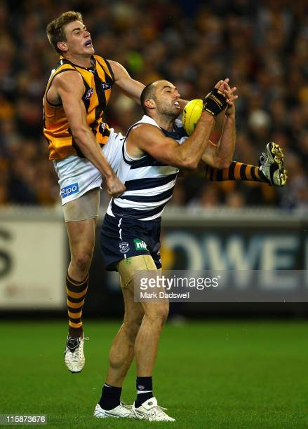 James Podsiadly of the Cats marks in front of Ryan Schoenmakers of the Hawks during the round 12 AFL match between the Geelong Cats and the Hawthorn...