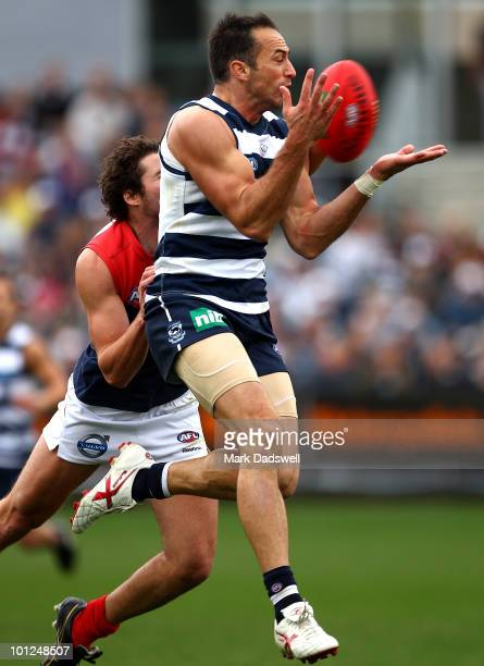 James Podsiadly of the Cats marks on a lead during the round 10 AFL match between the Geelong Cats and the Melbourne Demons at Skilled Stadium on May...