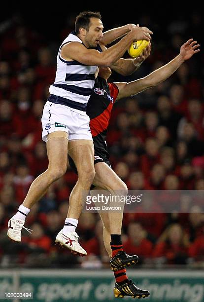 James Podsiadly of the Cats marks the ball during the round 12 AFL match between the Essendon Bombers and the Geelong Cats at Etihad Stadium on June...