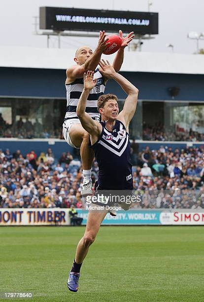 James Podsiadly of the Cats marks the ball high over Zac Dawson of the Dockers during the Second AFL Qualifying Final match between the Geelong Cats...
