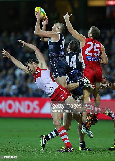 James Podsiadly of the Cats marks the ball over Shane Mumford of the Swans during the round 22 AFL match between the Geelong Cats and the Sydney...