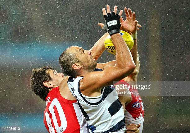 James Podsiadly of the Cats takes a mark during the round four AFL match between the Sydney Swans and the Geelong Cats at Sydney Cricket Ground on...