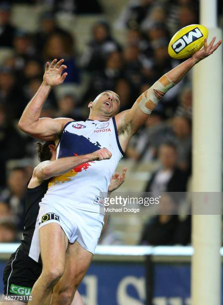 James Podsiadly of the Crows marks the ball one handed against Tyson Goldsack of the Magpies during the round 18 AFL match between the Collingwood...