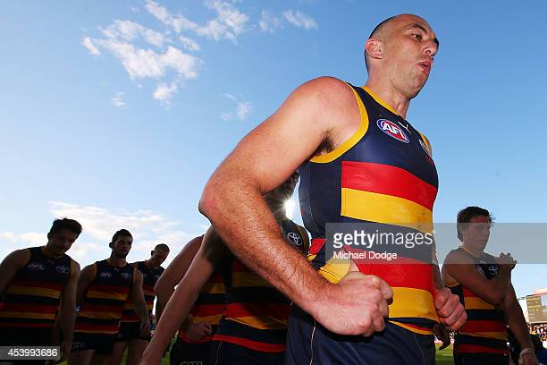 James Podsiadly of the Crows walk off the ground after defeat during the round 22 AFL match between the North Melbourne Kangaroos and the Adelaide...
