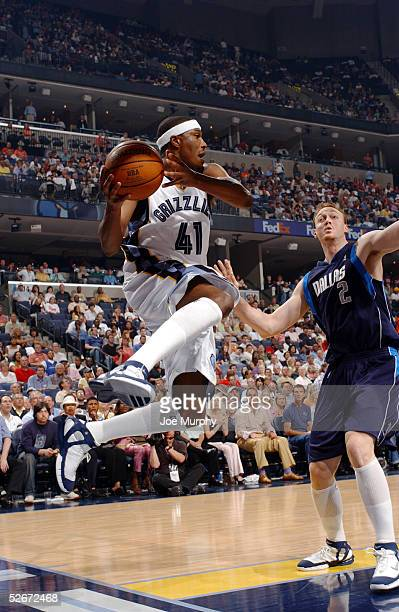 James Posey of the Memphis Grizzlies looks to pass the ball as he falls out of bounds against Keith Van Horn of the Dallas Mavericks on April 20 2005...