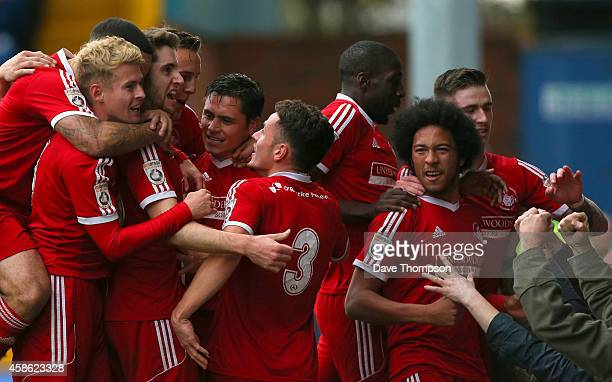 James Potton of Hemel Hempstead Town celebrates scoring the first goal of the game with his team mates during the FA Cup First Round match between...