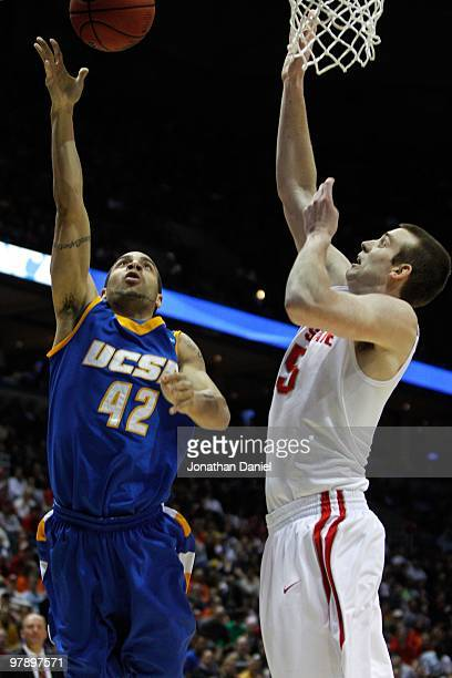 James Powell of the UC Santa Barbara Gauchos goes up for a layup against Kyle Madsen of the Ohio State Buckeyes during the first round of the 2010...