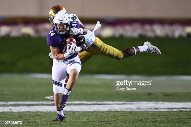 James Prather of the Northwestern Wildcats is brought down by Julian Okwara of the Notre Dame Fighting Irish during the first half of a game at Ryan...