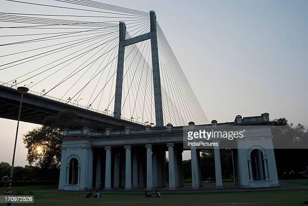 James Prinsep Memorial near Prinsep Ghat with Second Hooghly Bridge in the background, Kolkata, West Bengal, India.