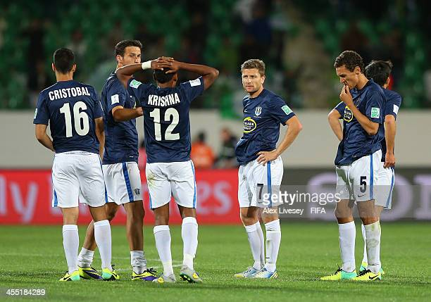James Pritchett and Angel Berlanga of Auckland City FC look dejected along with team mates after defeat in the FIFA Club World Cup PlayOff for the...