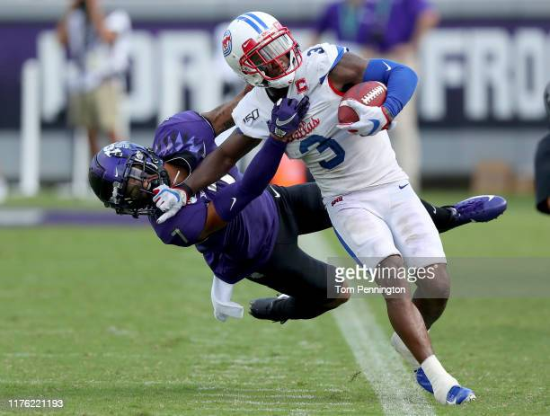 James Proche of the Southern Methodist Mustangs carries the ball against Trevon Moehrig of the TCU Horned Frogs in the second quarter at Amon G....