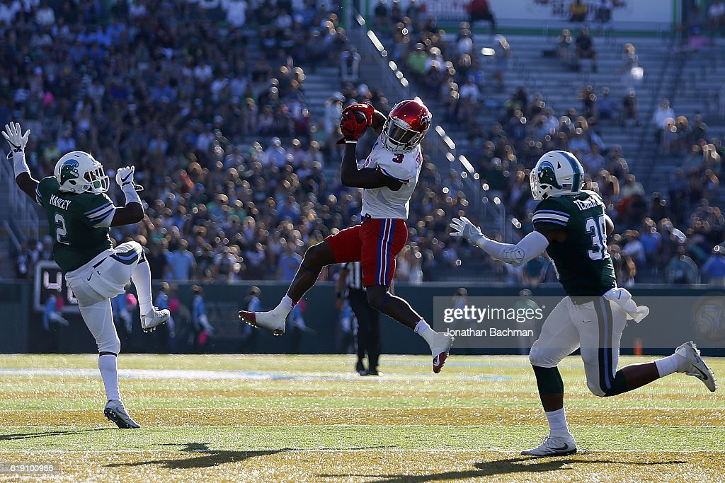 James Proche #3 of the Southern Methodist Mustangs catches the ball over Nico Marley #2 of the Tulane Green Wave and Roderic Teamer #38 during the first half of a game at Yulman Stadium on October 29, 2016 in New Orleans, Louisiana.