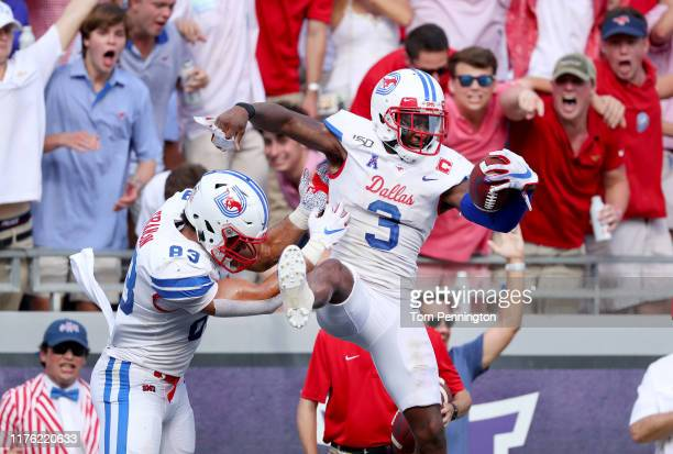 James Proche of the Southern Methodist Mustangs celebrates with Kylen Granson of the Southern Methodist Mustangs after scoring a touchdown against...