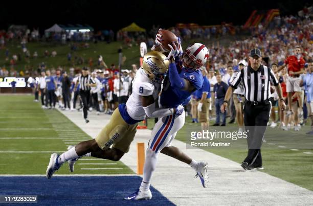 James Proche of the Southern Methodist Mustangs makes the game winning touchdown pass against Brandon Johnson of the Tulsa Golden Hurricane in...