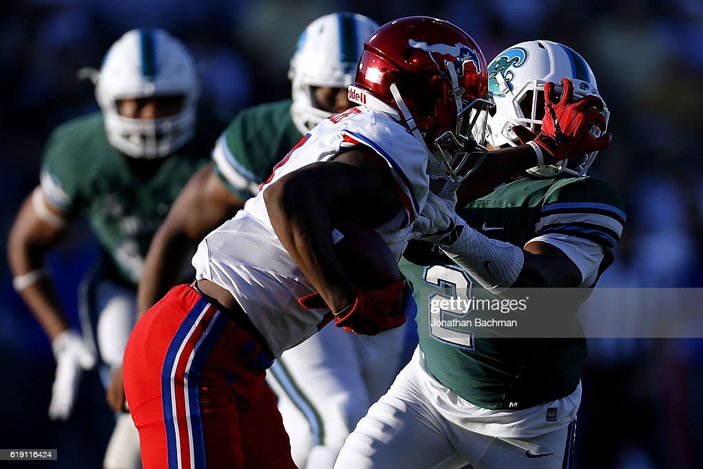 James Proche #3 of the Southern Methodist Mustangs stiff arms Nico Marley #2 of the Tulane Green Wave during the second half of a game at Yulman Stadium on October 29, 2016 in New Orleans, Louisiana.