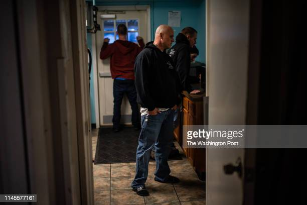 James Proffit waits in line to takes his daily medication at Sojourner Recovery's campus a treatment facility on Wednesday April 3 in Hamilton OH...