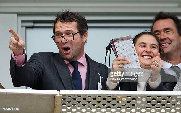 James Purefoy and Jessica Adams watch the racing as they attend the Hennessy Gold Cup horse racing meet at Newbury Racecourse on November 28, 2015 in...