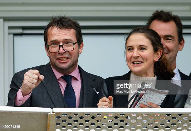James Purefoy and Jessica Adams watch the racing as they attend the Hennessy Gold Cup horse racing meet at Newbury Racecourse on November 28 2015 in...