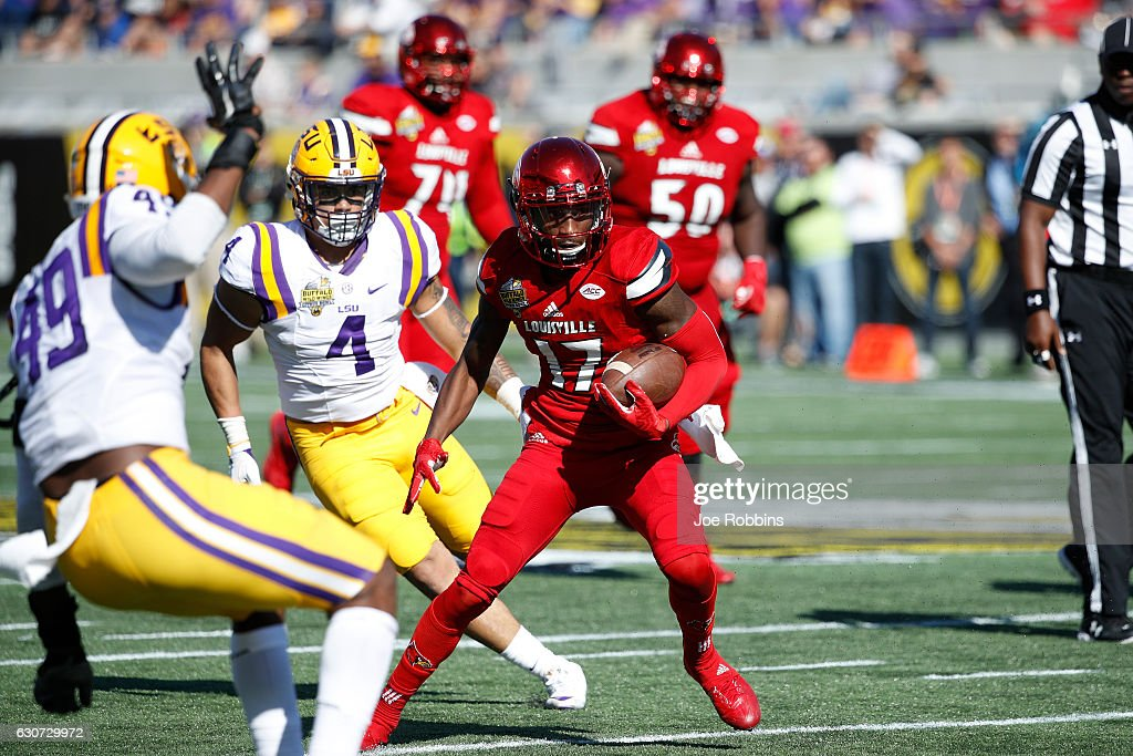 James Quick #17 of the Louisville Cardinals looks for running room after a reception against the LSU Tigers in the third quarter of the Buffalo Wild Wings Citrus Bowl at Camping World Stadium on December 31, 2016 in Orlando, Florida. LSU defeated Louisville 29-9.