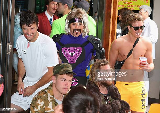 James Rahilly assistant coach dressed as Luis Suárez Dale Amos as White Goodman from Dodgeball and Mitch Duncan of the Cats dressed as a festivalgoer...