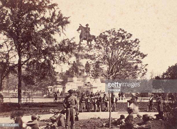 James Reekie photographed groups of paroled Confederate soldiers and recreating Federal soldiers in front of the Washington Monument Capitol Square...