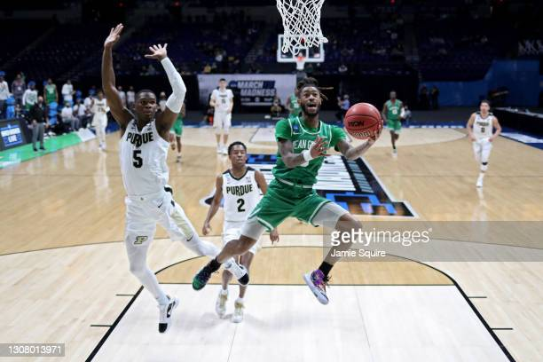 James Reese of the North Texas Mean Green attempts a layup past Brandon Newman of the Purdue Boilermakers in the first half in the first round game...