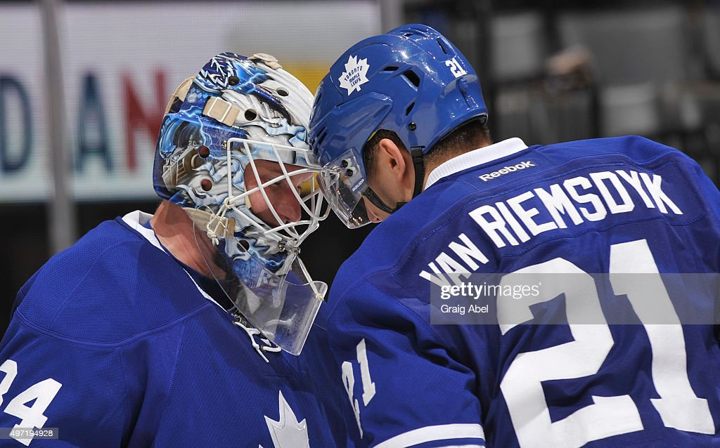 James Reimer #34 and James van Riemsdyk #21 of the Toronto Maple Leafs celebrate the teams win over the Vancouver Canucks during NHL game action November 14, 2015 at Air Canada Centre in Toronto, Ontario, Canada.