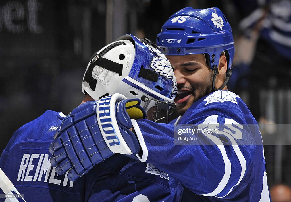James Reimer #34 and Mark Fraser #45 of the Toronto Maple Leafs celebrate the teams win over the New Jersey Devils during NHL game action April 15, 2013 at the Air Canada Centre in Toronto, Ontario, Canada.