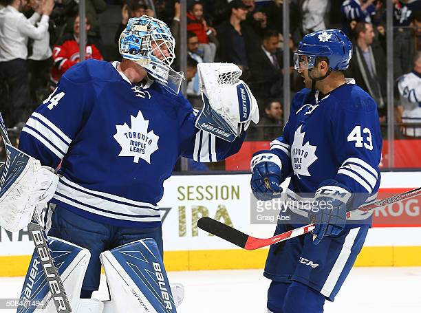 James Reimer and Nazem Kadri of the Toronto Maple Leafs celebrate the win over the New Jersey Devils during game action on February 4 2016 at Air...