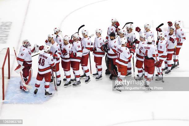 James Reimer of the Carolina Hurricanes celebrates with his teammates after defeating the New York Rangers in Game Three of the Eastern Conference...