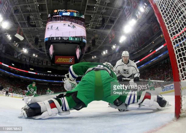 James Reimer of the Carolina Hurricanes goes down in the crease and makes a pad save after a shot on net by Adrian Kempe of the Los Angeles Kings...