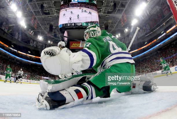 James Reimer of the Carolina Hurricanes goes down in the crease to protect the net during an NHL game against the Los Angeles Kings on January 11...